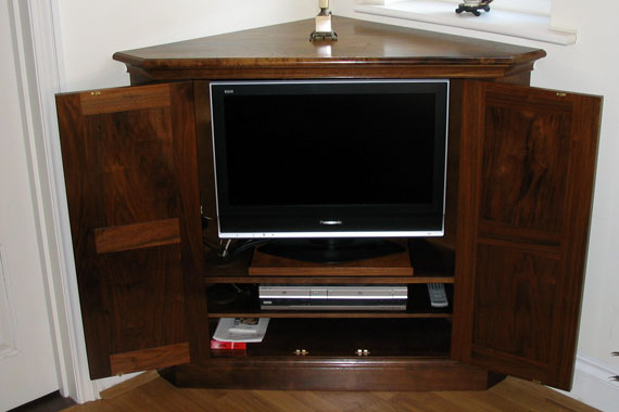 Wooden cabinet with television inside